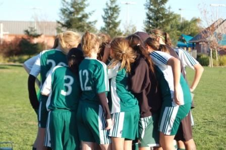 Image of girls soccer team in huddle
