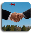 Airport Partners image of a hand shake with a red airplane in far background