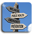Wooden street sign pointing to wellness public health emergency and prevention