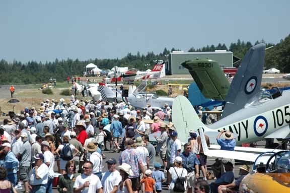 Crowd of people at airfield with special planes